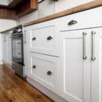 Stylish Light Gray Handles On Cabinets Close Up, Kitchen Interio